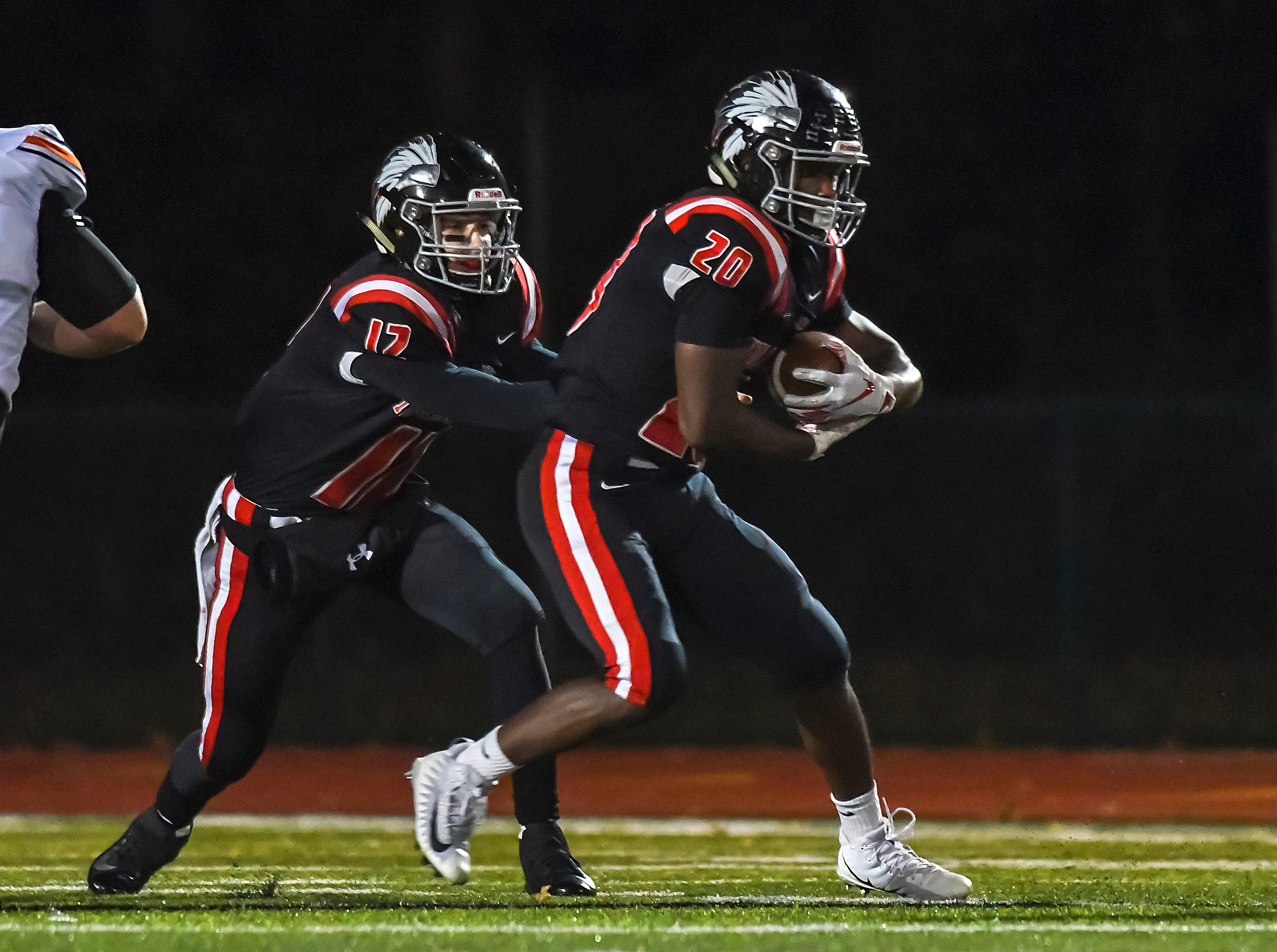 Braves John Mark Williams (20) takes a handoff from Cole Dein (12) against Waerly in the OHSAA D4 Region 16 Playoffs at Indian Hill High School, Saturday, Nov. 3, 2018