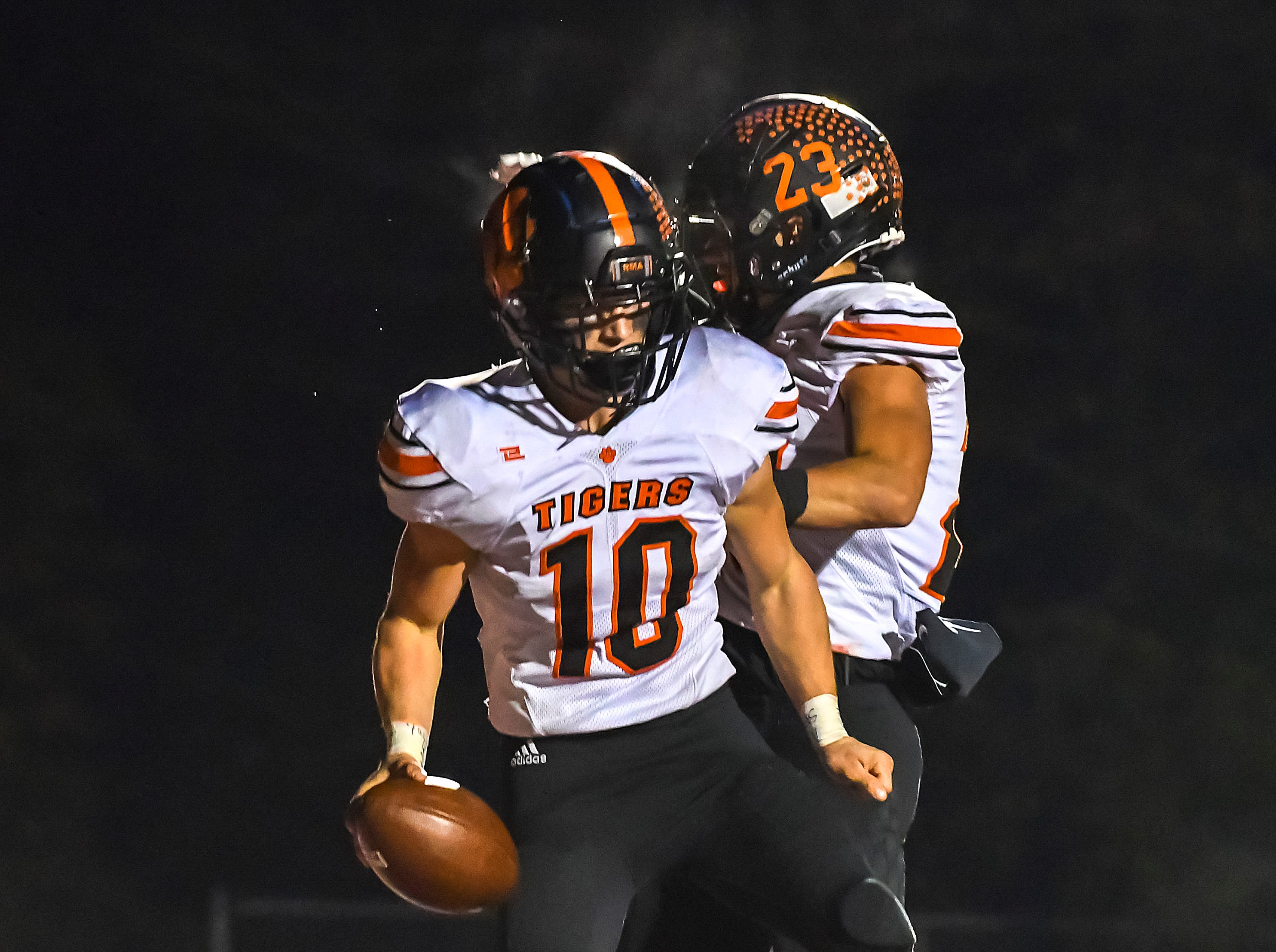 Payton Shoemaker (10) and Easton Wolf of Waverly celebrate after a touchdown against Indian Hill in the OHSAA D4 Region 16 Playoffs at Indian Hill High School, Saturday, Nov. 3, 2018