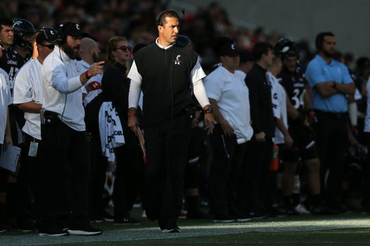 Cincinnati Bearcats head coach Luke Fickell paces the sideline in the second quarter during a college football game between the Navy Midshipmen and the Cincinnati Bearcats, Saturday, Nov. 3, 2018, at Nippert Stadium in Cincinnati.