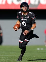 Cincinnati Bearcats quarterback Desmond Ridder (9) runs out of the pocket in the second quarter during a college football game between the Navy Midshipmen and the Cincinnati Bearcats, Saturday, Nov. 3, 2018, at Nippert Stadium in Cincinnati.