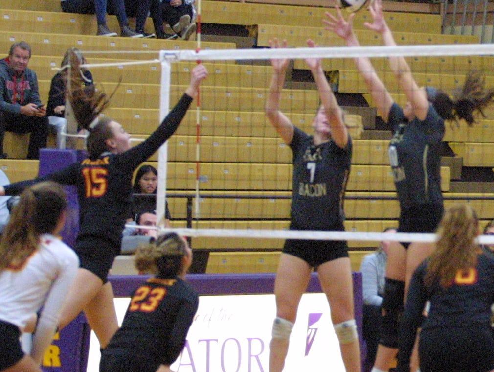 Bishop Fenwick players Julia Gardon (15) and Brooklyn Brunner (23) in the regional final at Butler High School, Saturday, Nov. 3, 2018.