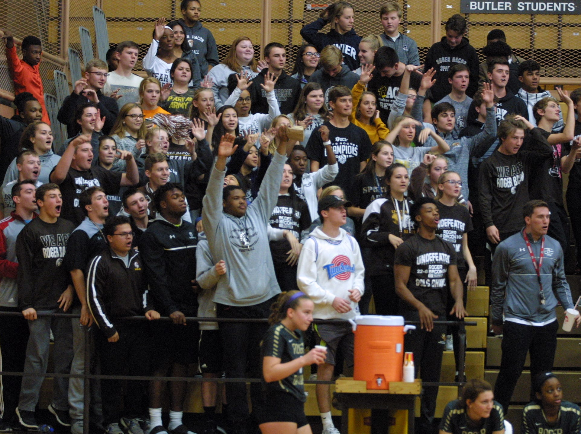 Roger Bacon fans cheer during their team's match against Bishop Fenwick in the regional final at Butler High School, Saturday, Nov. 3, 2018.