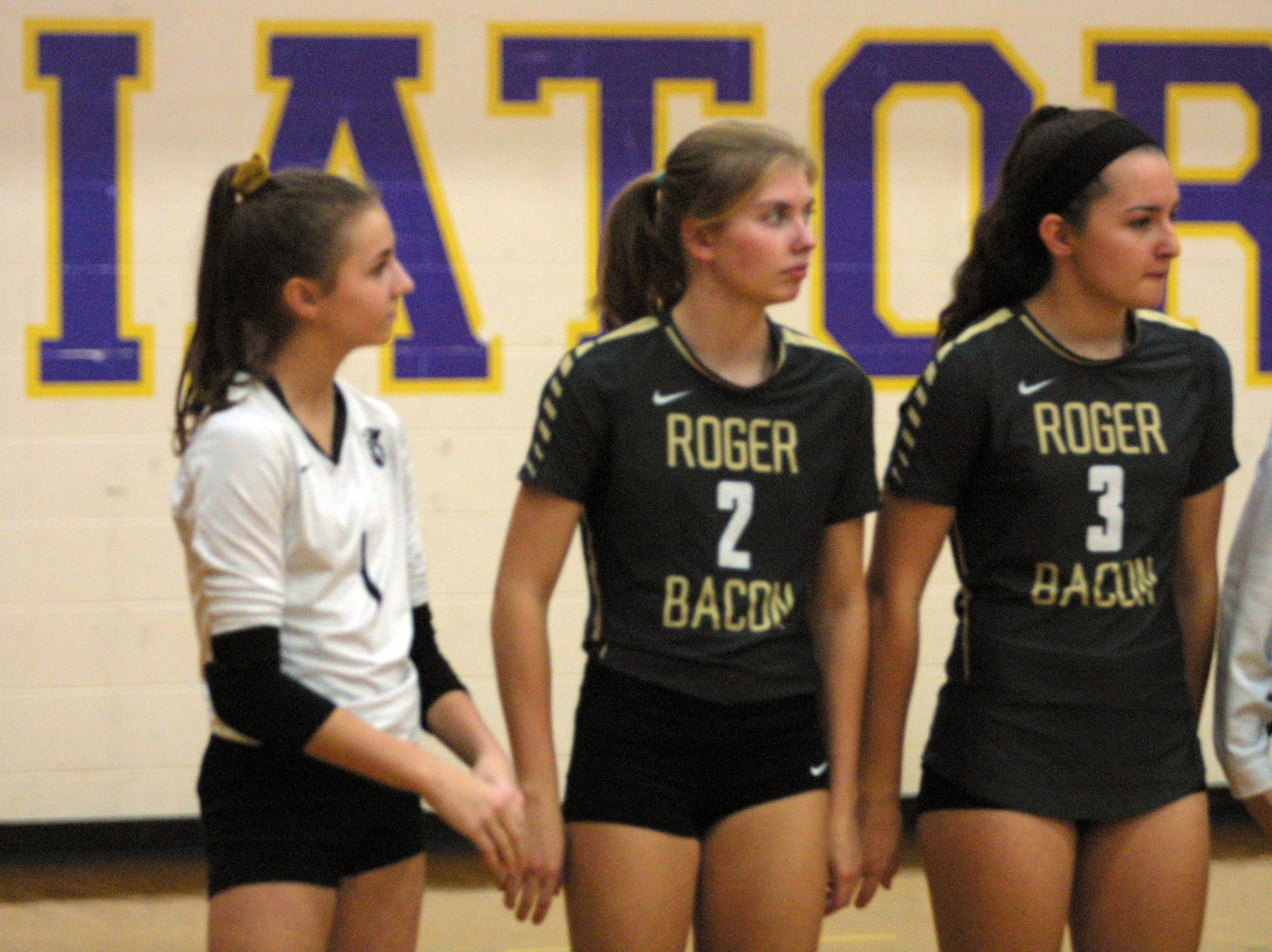 Roger Bacon players Cammy Niesen (1), Mary Kate Dewees (2) and Sarah Dougoud (3) are announced before their team's match against Bishop Fenwick in the regional final at Butler High School, Saturday, Nov. 3, 2018.