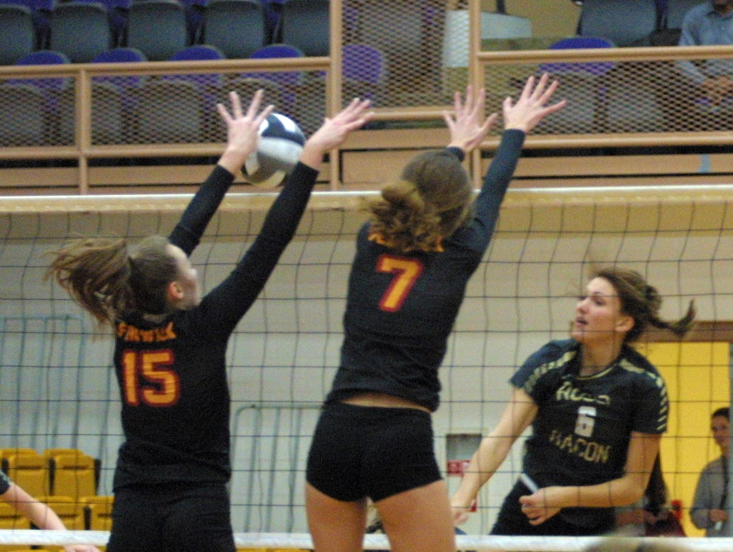 Roger Bacon's Grace Wilking spikes the ball during her team's match against Bishop Fenwick in the regional final at Butler High School, Saturday, Nov. 3, 2018.