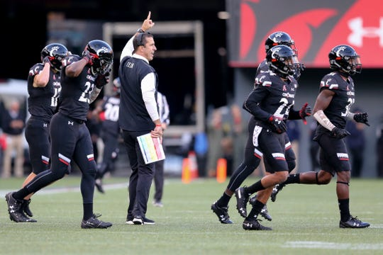 Cincinnati Bearcats head coach Luke Fickell instructs the team in the fourth quarter during a college football game between the Navy Midshipmen and the Cincinnati Bearcats, Saturday, Nov. 3, 2018, at Nippert Stadium in Cincinnati.