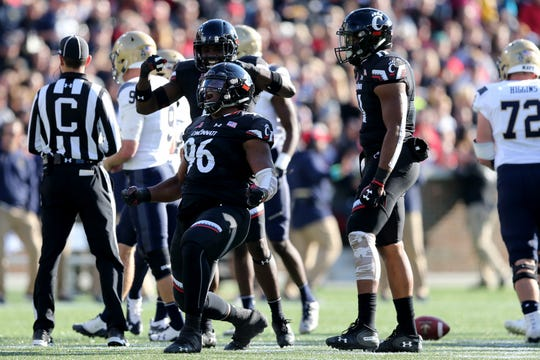 Cincinnati Bearcats defensive tackle Cortez Broughton (96) celebrates a sack in the first quarter during a college football game between the Navy Midshipmen and the Cincinnati Bearcats, Saturday, Nov. 3, 2018, at Nippert Stadium in Cincinnati.