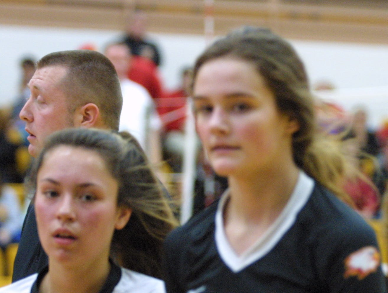Bishop Fenwick players Bella DeSalvo (13) and Elizabeth Hoerlein (7) walk off after a lost point against Roger Bacon in the regional final at Butler High School, Saturday, Nov. 3, 2018.