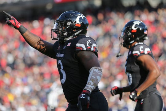 Cincinnati Bearcats running back Michael Warren II (3) reacts after scoring a touchdown in the second quarter during a college football game between the Navy Midshipmen and the Cincinnati Bearcats, Saturday, Nov. 3, 2018, at Nippert Stadium in Cincinnati.