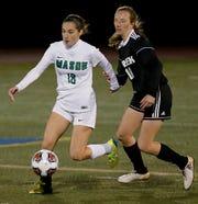 Mason defender Meghan Curran stays ahead of Beavercreek forward Kaileigh Nuessgen during their girls soccer DI regional finals at Monroe Saturday, Nov. 3, 2018.