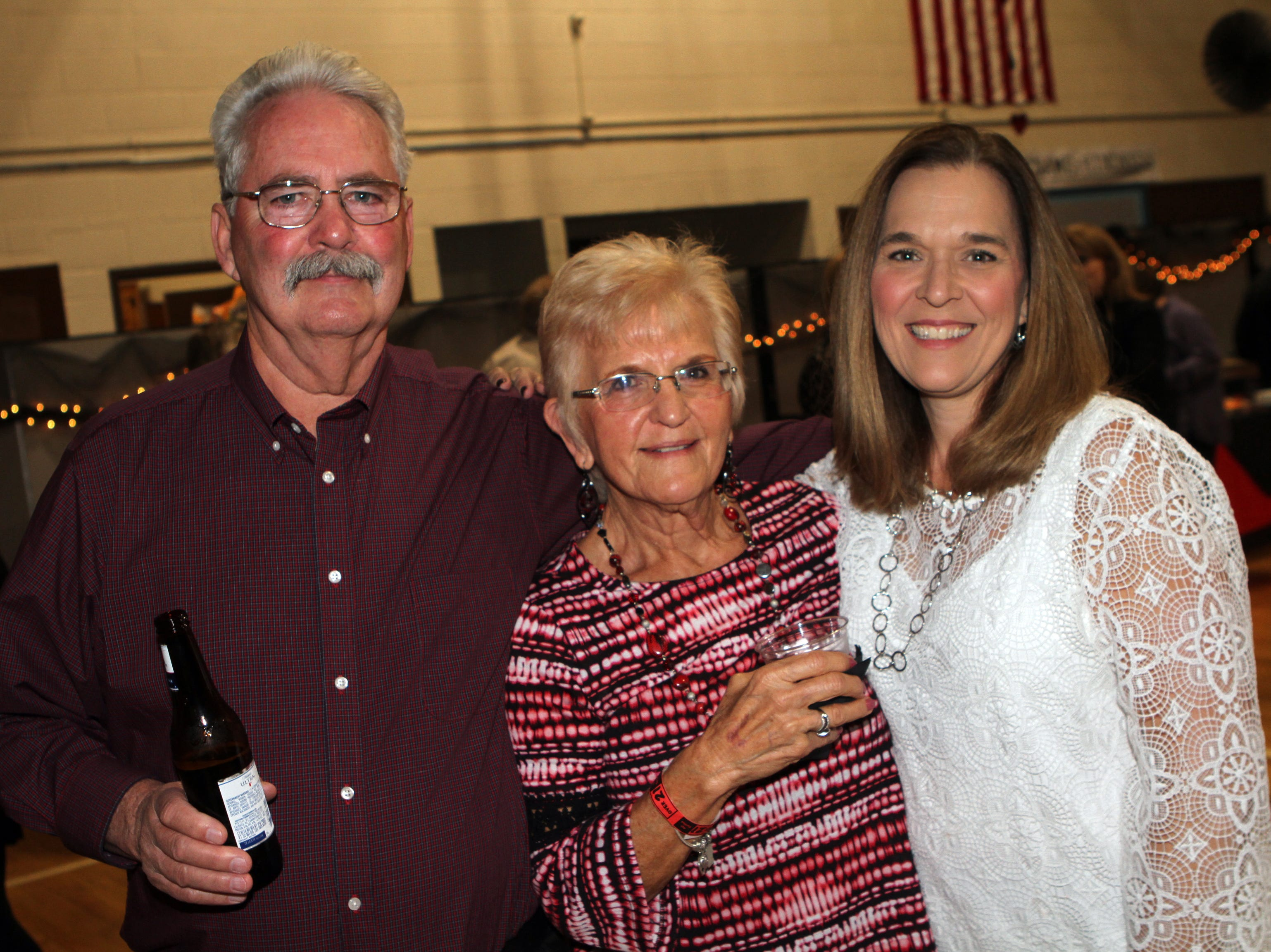 Phllip Anderson, Mary Ann Harris and Lisa Meeks at Casino Night at Immaculate Conception School on Saturday, Nov. 3, 2018.