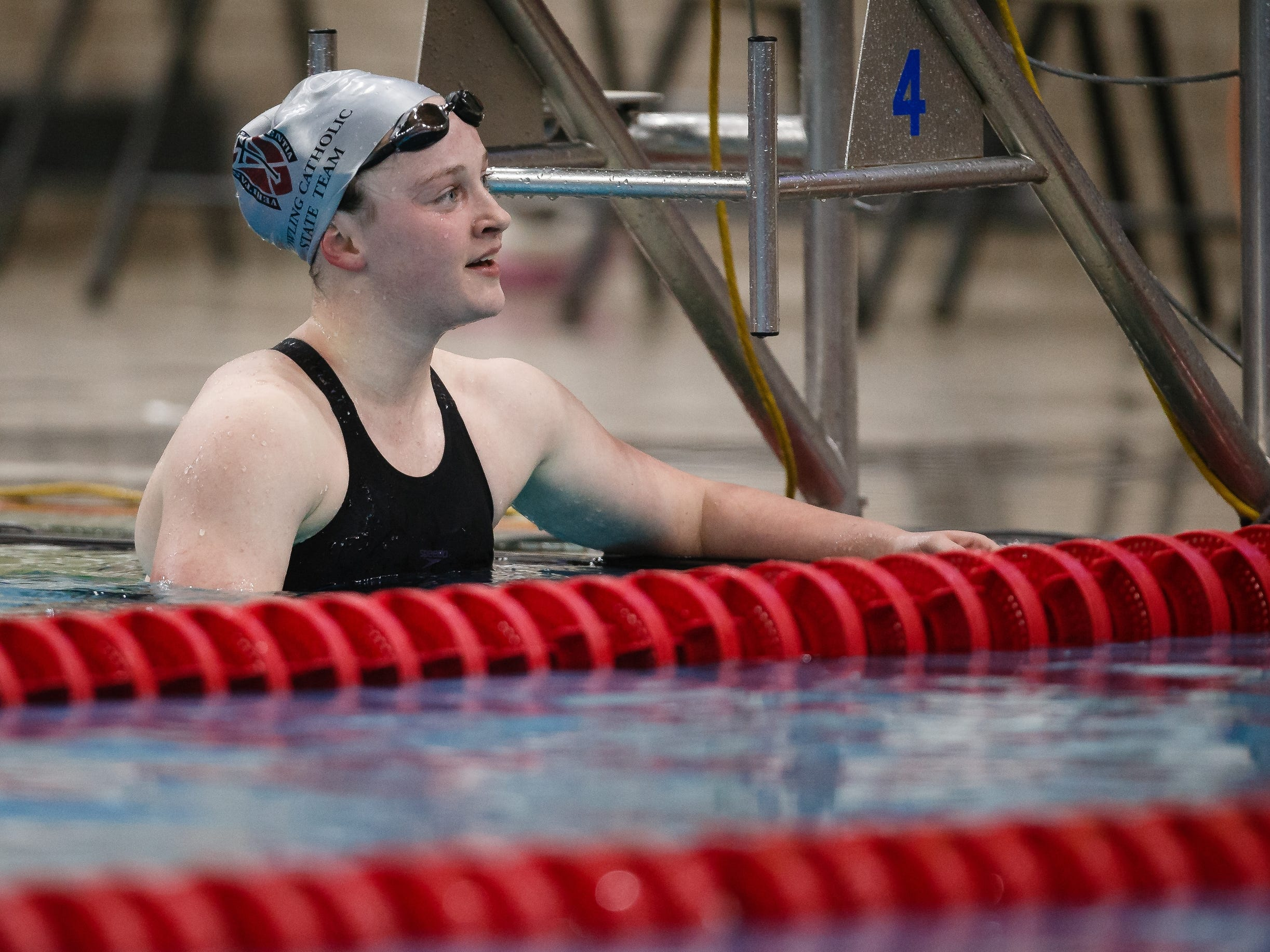 Dowling Catholic's Berit Quass looks up at the clock after the 500 yard freestyle at the Iowa girls state swimming meet on Saturday, Nov. 3, 2018, in Marshalltown.