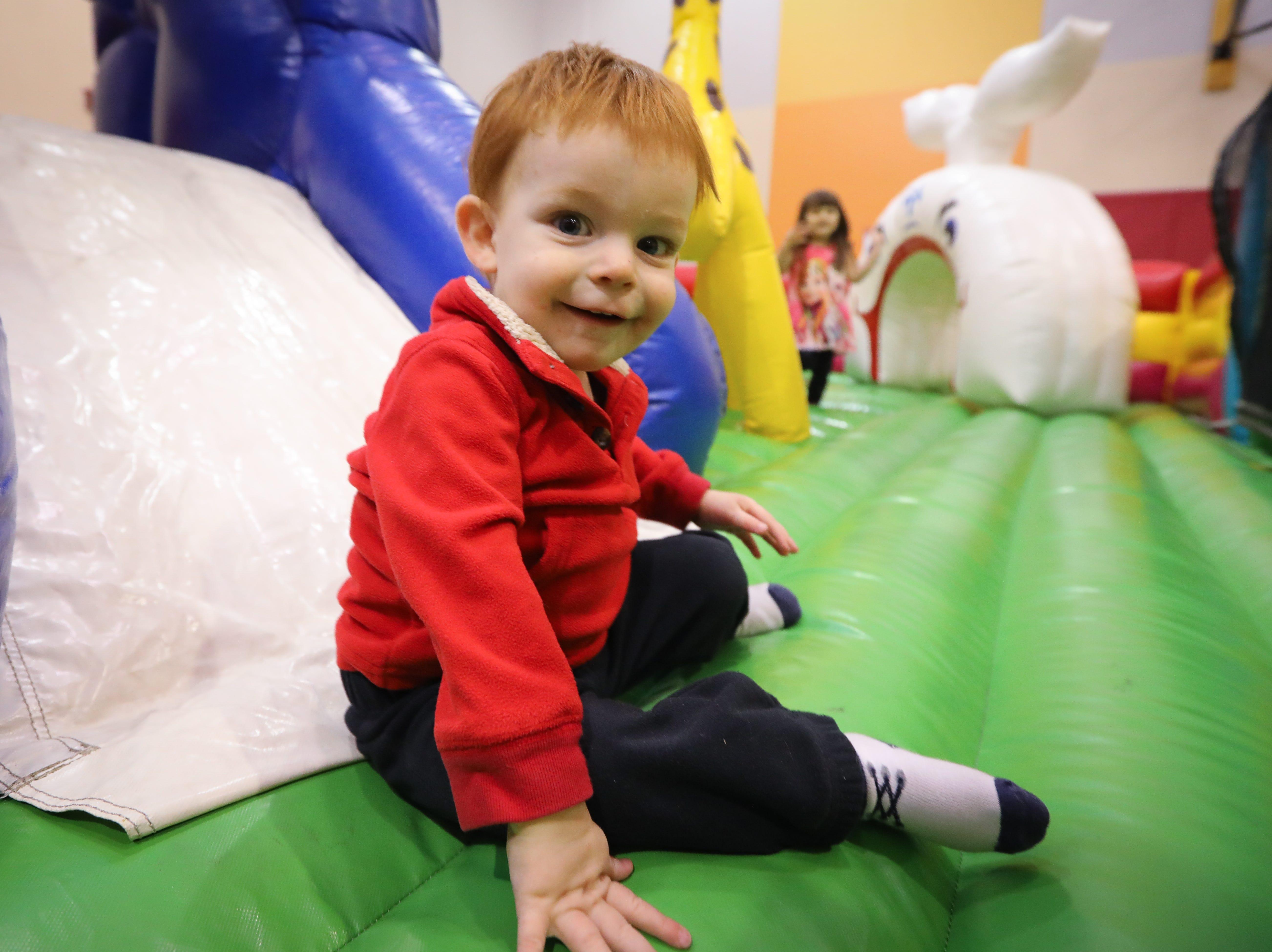 Brogan, 1, of Adel participates in the Preschool Palooza at Hillside Elementary School on Saturday, Nov. 3, 2018 in Des Moines, Iowa.