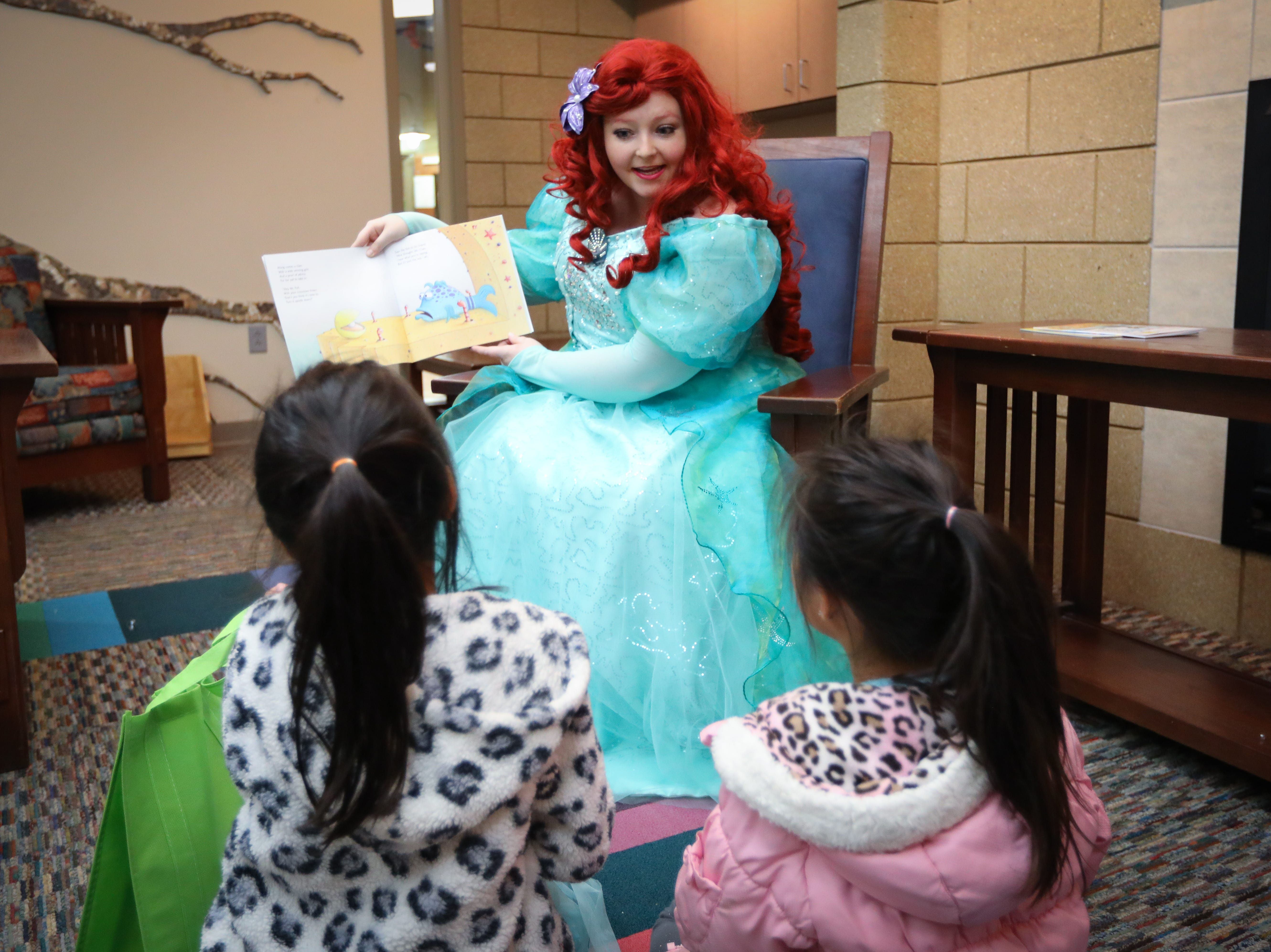 Preschoolers listen to a Disney Princess during a storytelling session in the Preschool Palooza at Hillside Elementary School on Saturday, Nov. 3, 2018 in Des Moines, Iowa.