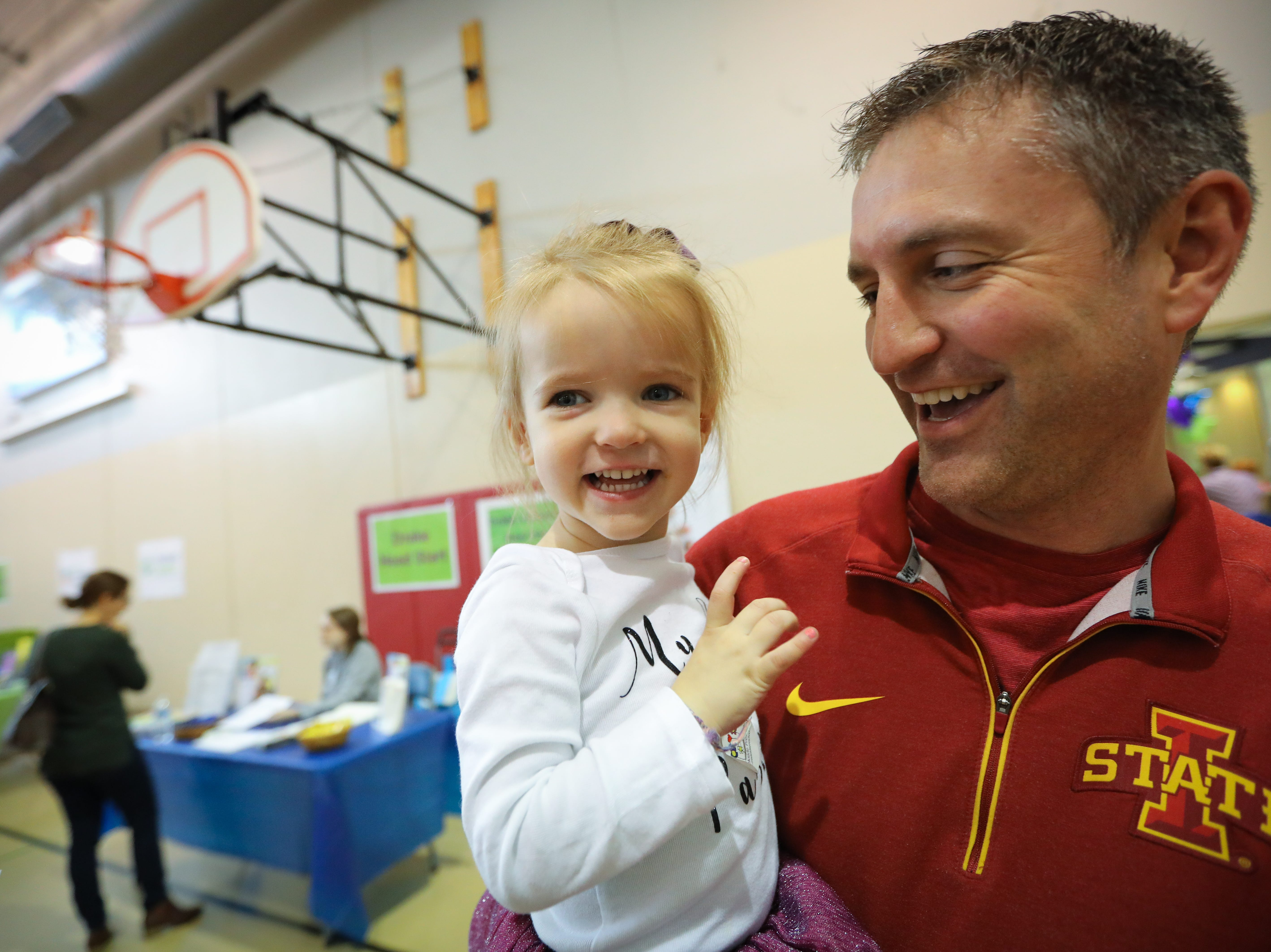 Jayla, 2, of West Des Moines and her father, Jason Vos, participate in the Preschool Palooza at Hillside Elementary School on Saturday, Nov. 3, 2018 in Des Moines, Iowa.