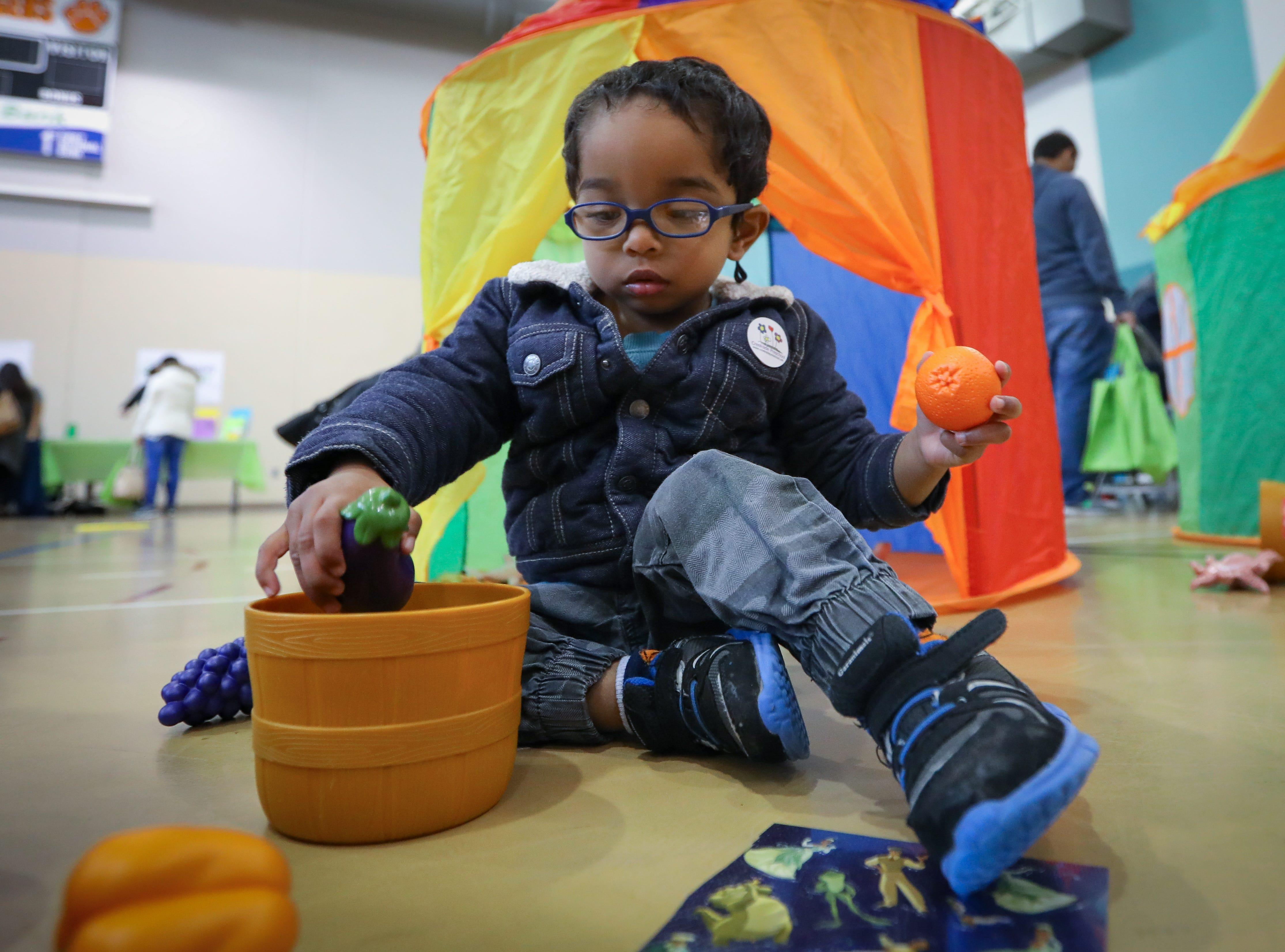 Gavin, 2 of Des Moines participates in the Preschool Palooza at Hillside Elementary School on Saturday, Nov. 3, 2018 in Des Moines, Iowa.