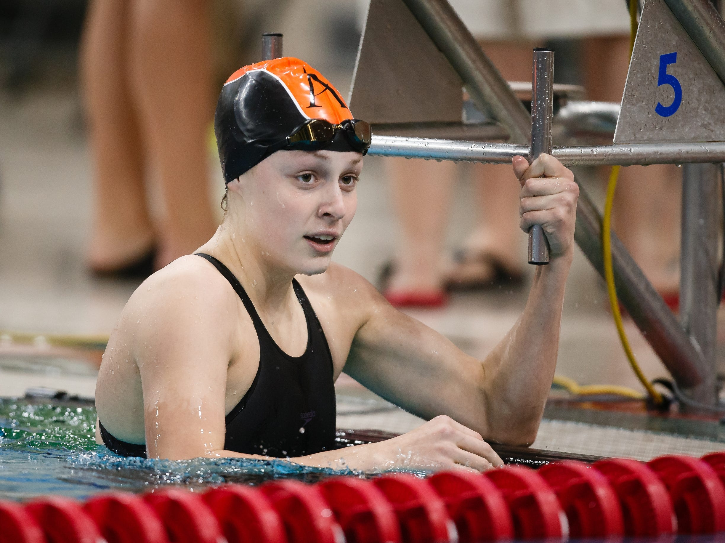 Ames' Molly Winer looks at the crowd after competing in the 100 yard breaststroke at the Iowa girls state swimming meet on Saturday, Nov. 3, 2018, in Marshalltown.