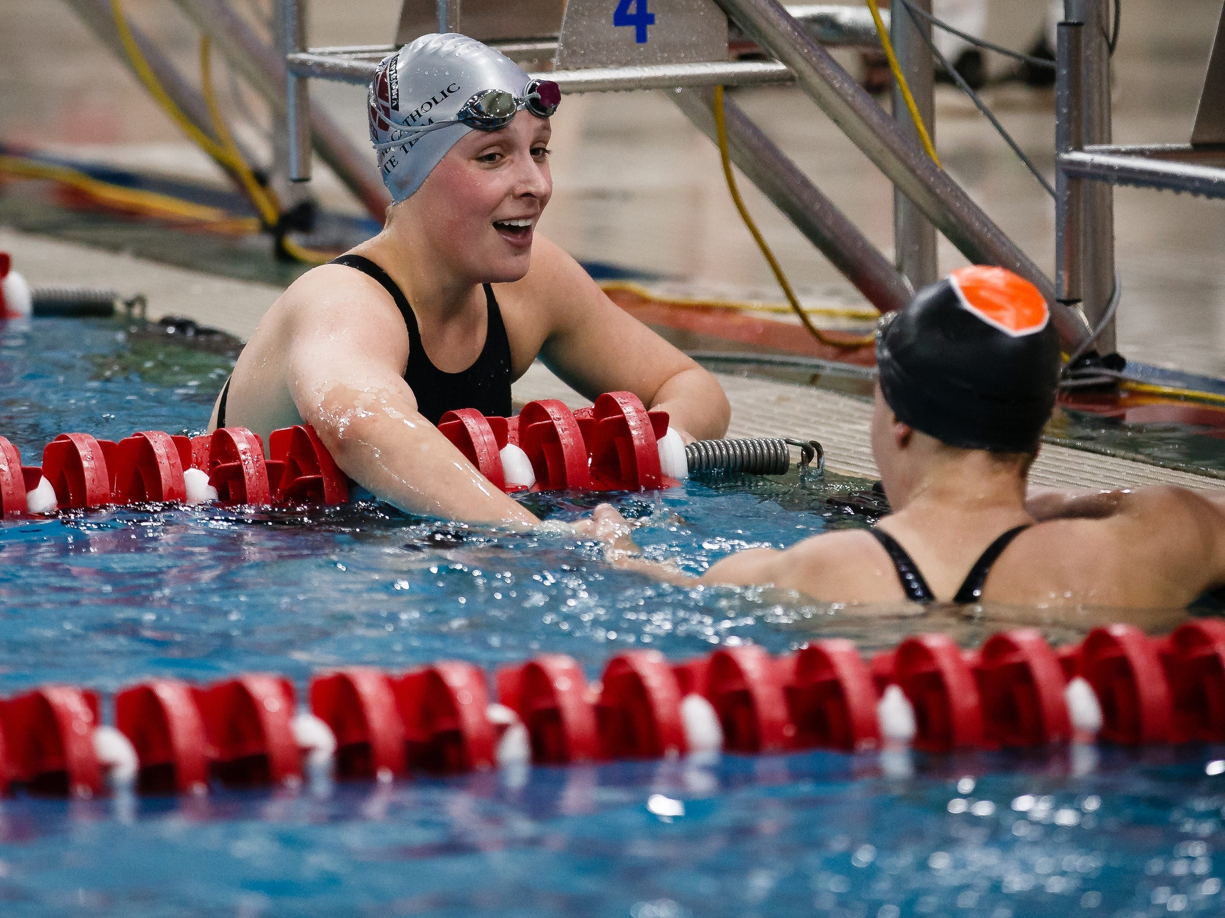 Dowling Catholics Claire Culver congratulates Amy Feddersen of Ames after the 200 yard freestyle event at the Iowa girls state swimming meet on Saturday, Nov. 3, 2018, in Marshalltown.