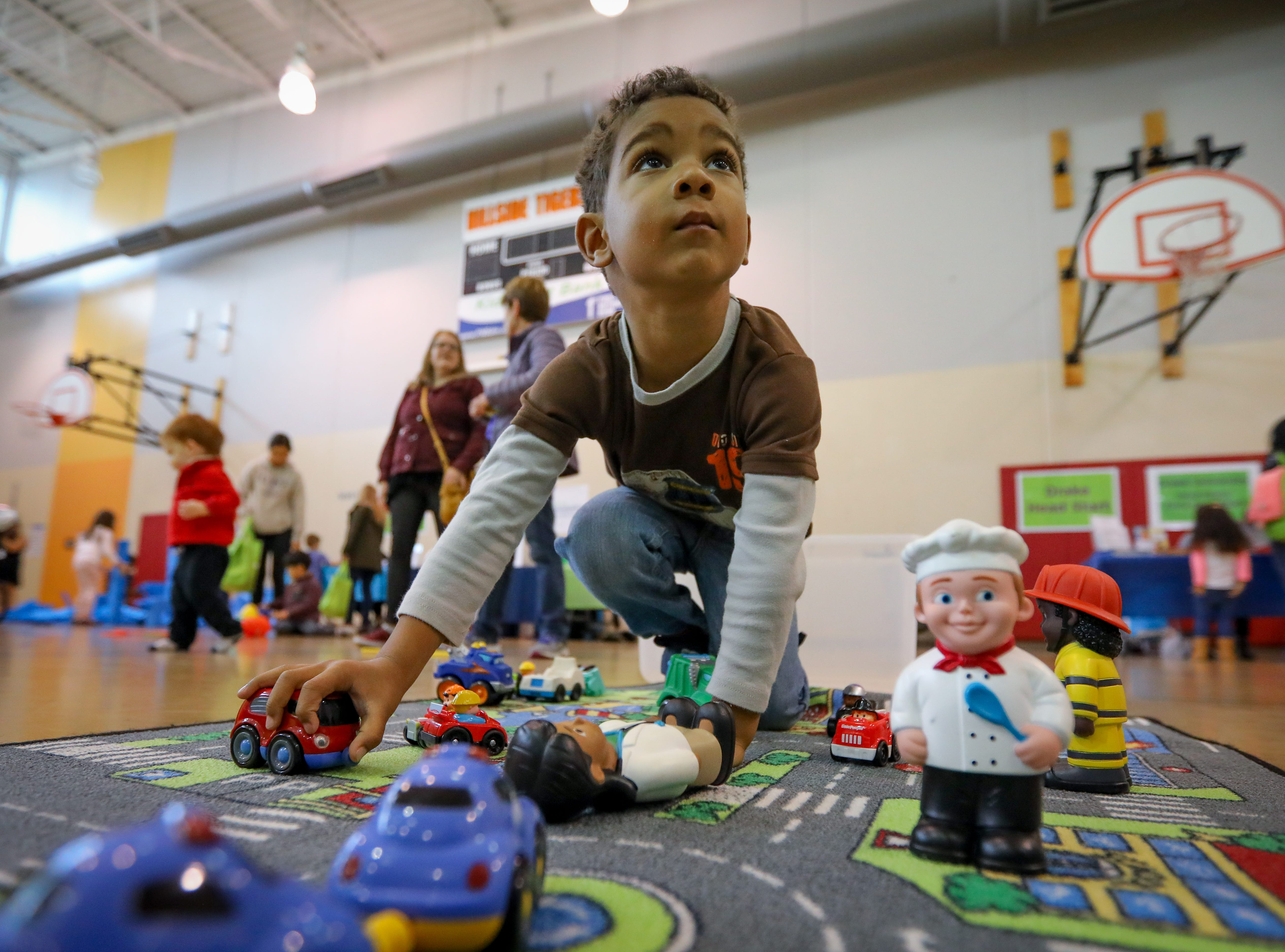 A young kid participates in the Preschool Palooza at Hillside Elementary School on Saturday, Nov. 3, 2018 in Des Moines, Iowa.