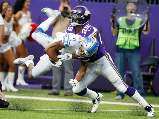 Lions wide receiver Marvin Jones is tackled by Vikings cornerback Xavier Rhodes after making a reception during the first half on Sunday, Nov. 4, 2018, in Minneapolis.