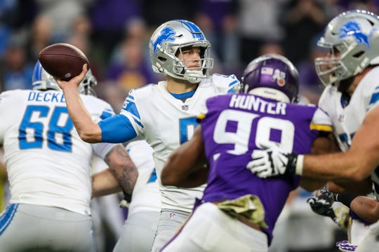 Lions quarterback Matthew Stafford throws a pass during the first quarter on Sunday, Nov. 4, 2018, in Minneapolis.