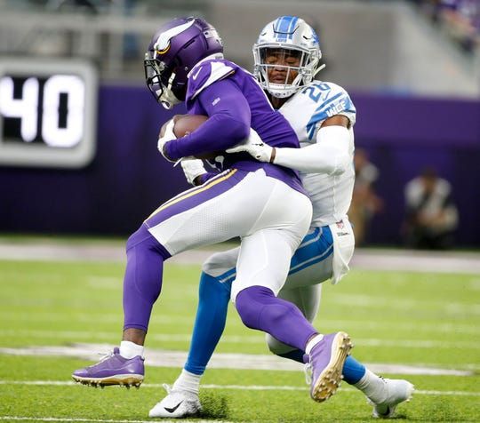 Vikings wide receiver Laquon Treadwell is tackled by Lions defensive back DeShawn Shead, right, after making a reception during the first half on Sunday, Nov. 4, 2018, in Minneapolis.