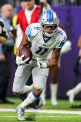 Lions wide receiver Marvin Jones Jr. carries the ball during the first quarter on Sunday, Nov. 4, 2018, in Minneapolis.