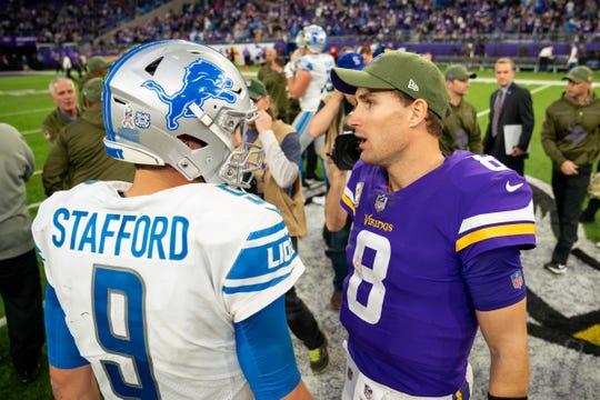Lions quarterback Matthew Stafford and Vikings quarterback Kirk Cousins talk after the Lions' 24-9 loss Sunday, Nov. 4, 2018, in Minneapolis.