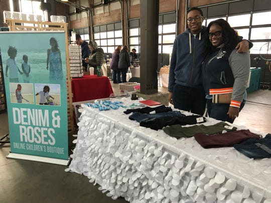 Eboni Chavers, co-founder of the online children's boutique Denim & Roses, poses with her 16-year-old son Javar Chavers at the All Things Detroit shopping experience at Eastern Market on Sunday, Nov. 4, 2018.
