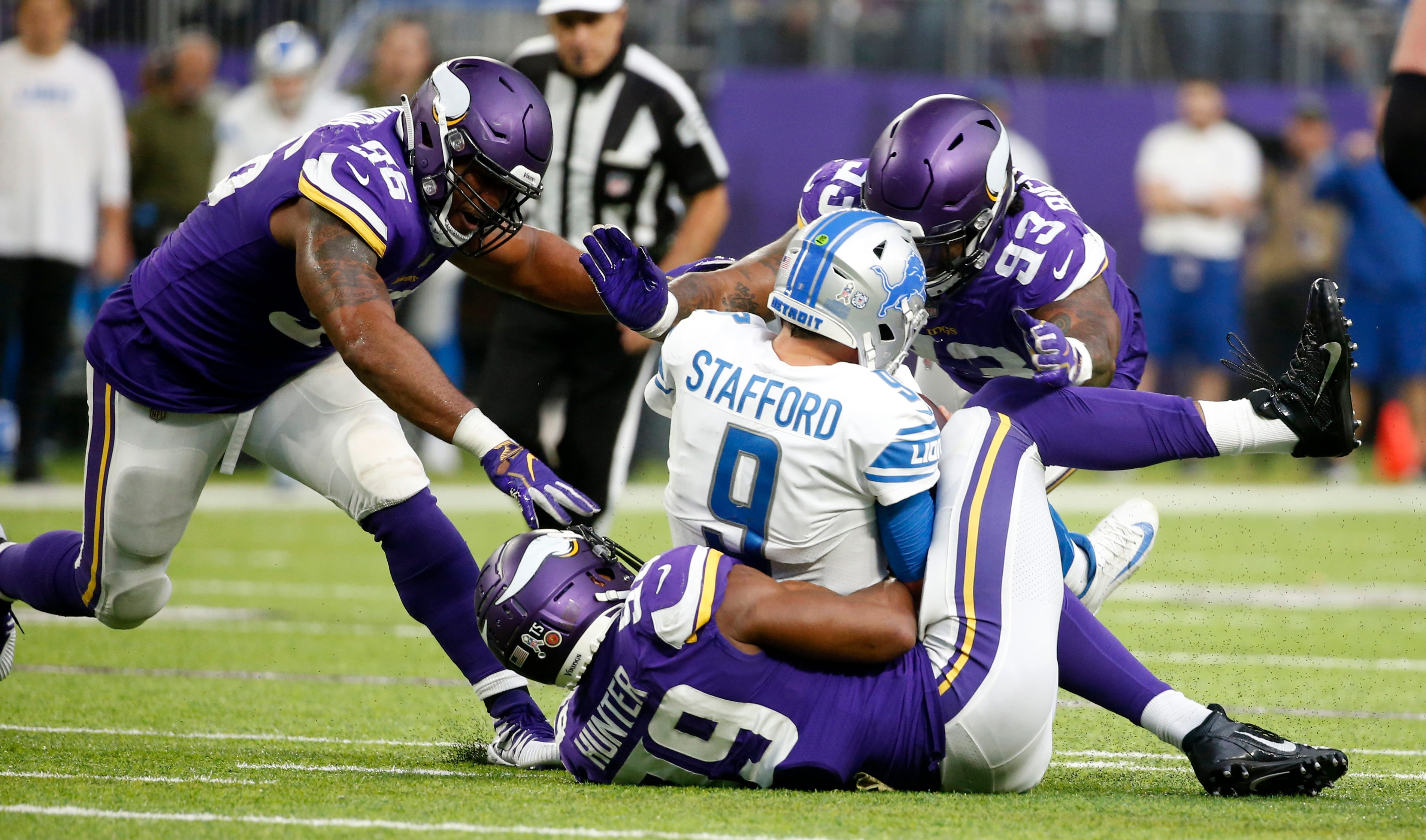 Lions quarterback Matthew Stafford is sacked by Vikings defenders Tom Johnson, left, Sheldon Richardson (93) and Danielle Hunter (99) during the first half on Sunday, Nov. 4, 2018, in Minneapolis.
