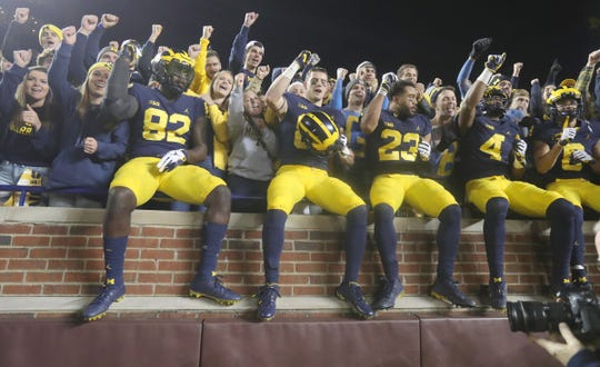 Michigan players celebrate with fans their 42-7 victory over Penn State, Saturday, Nov. 3, 2018 at Michigan Stadium.
