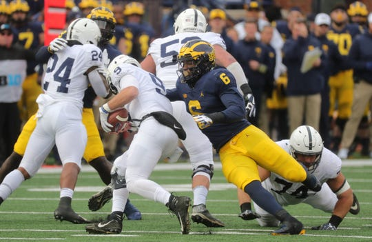 Michigan's Josh Uche sacks Penn State's Trace McSorley during the first half.