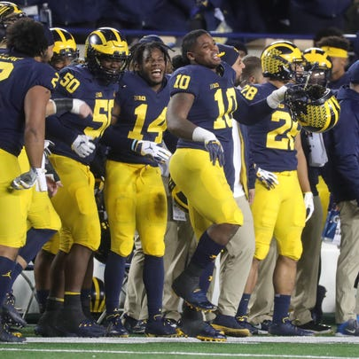 Michigan Players Including Linebacker Devin Bush  Celebrate In The Final Minutes