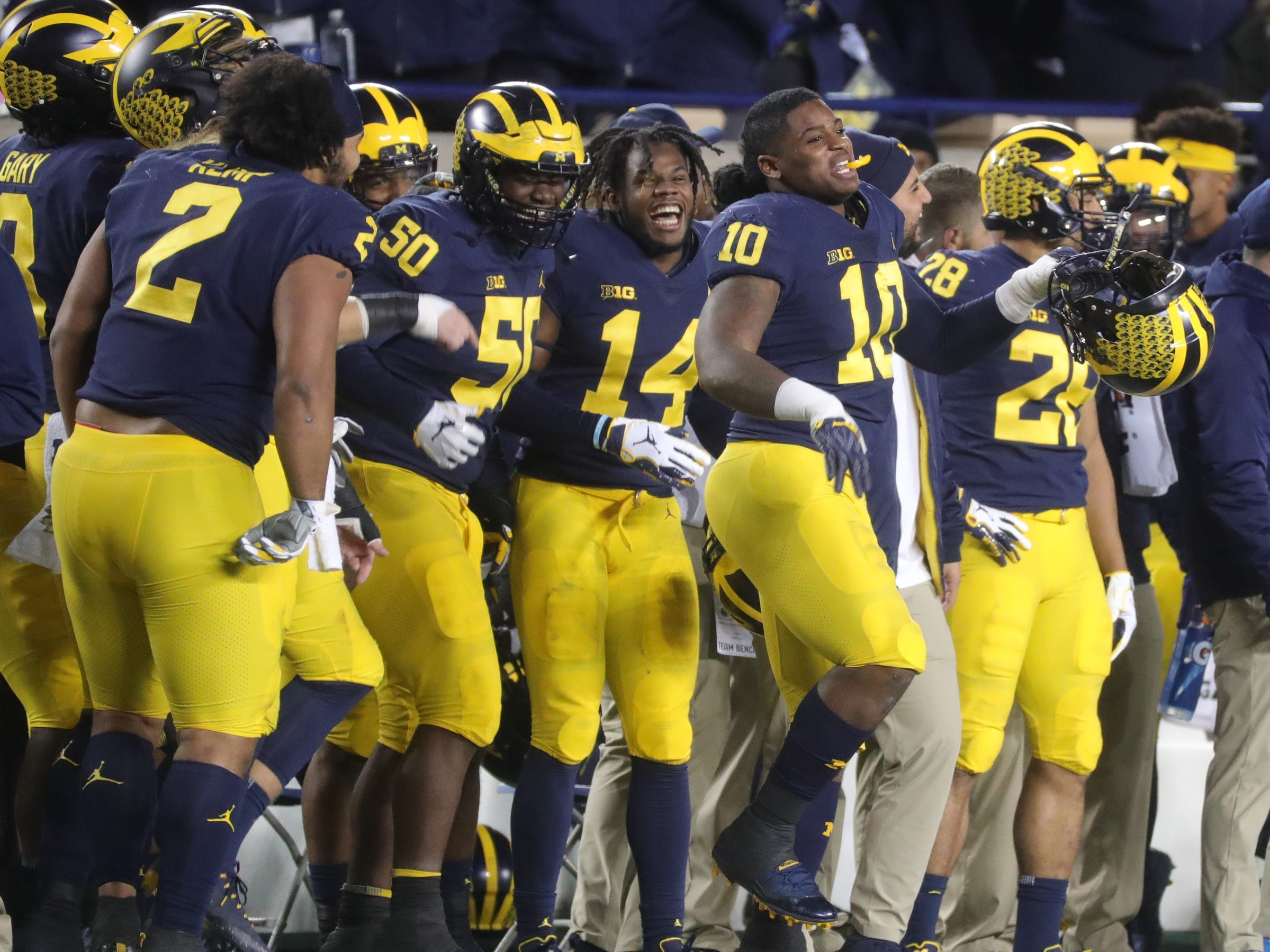 Michigan players, including linebacker Devin Bush (10), celebrate in the final minutes of the 42-7 victory over Penn State, Saturday, Nov. 3, 2018 at Michigan Stadium in Ann Arbor.
