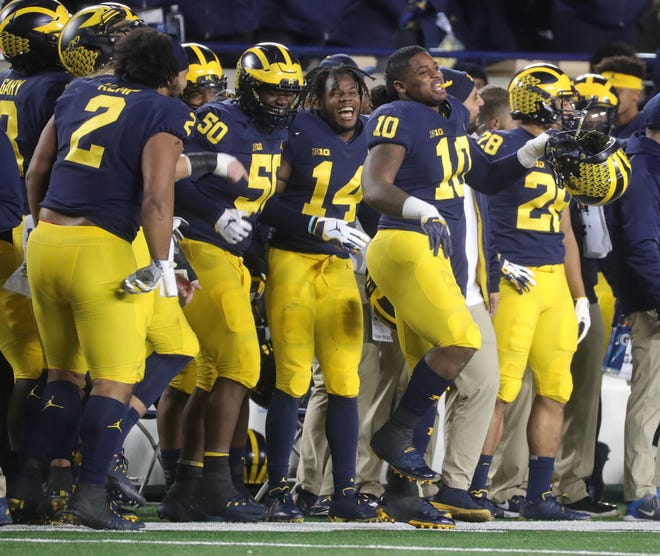 Michigan players celebrate in the final minutes of the 42-7 victory over Penn State.