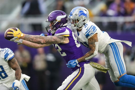 Minnesota Vikings tight end Kyle Rudolph catches a pass over Detroit Lions cornerback Teez Tabor during the fourth quarter at U.S. Bank Stadium, Nov. 4, 2018 in Minneapolis.
