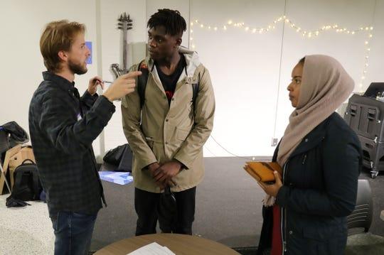 Wayne State students Billy Ireland, Cedric Mutebi and Tasha Mohamed talk before the NextGen voting seminar at the Wayne State Student Center in Detroit on Thursday, September 1, 2018.