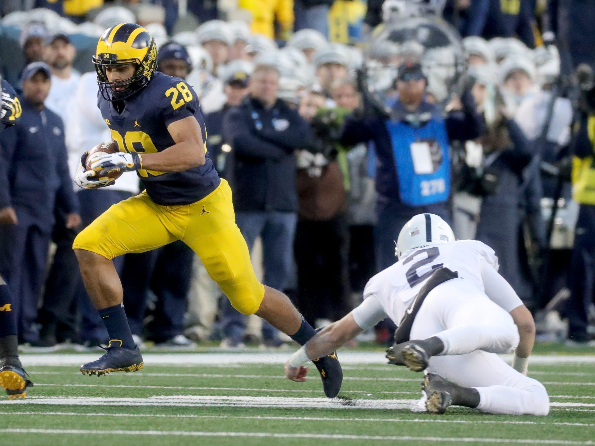 Michigan's Brandon Watson runs past Penn State quarterback Tommy Stevens to return an interception 62 yards for a touchdown in the second half Saturday, Nov. 3, 2018 at Michigan Stadium in Ann Arbor.
