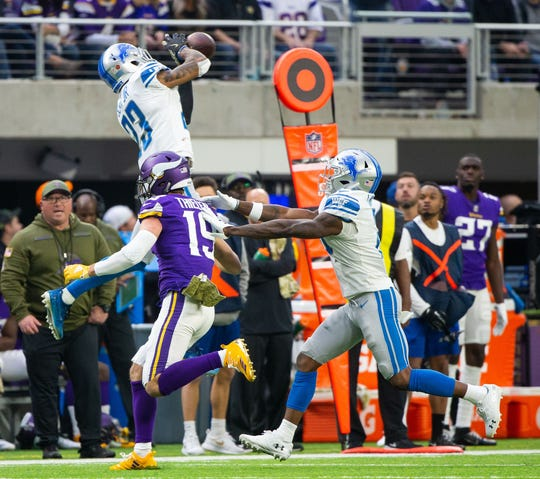 Lions defensive back Darius Slay intercepts Vikings quarterback Kirk Cousins in the second quarter Sunday, Nov. 4, 2018, in Minneapolis.