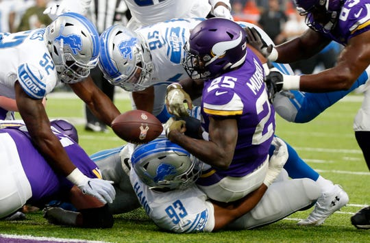 Vikings running back Latavius Murray scores a touchdown against the Lions.