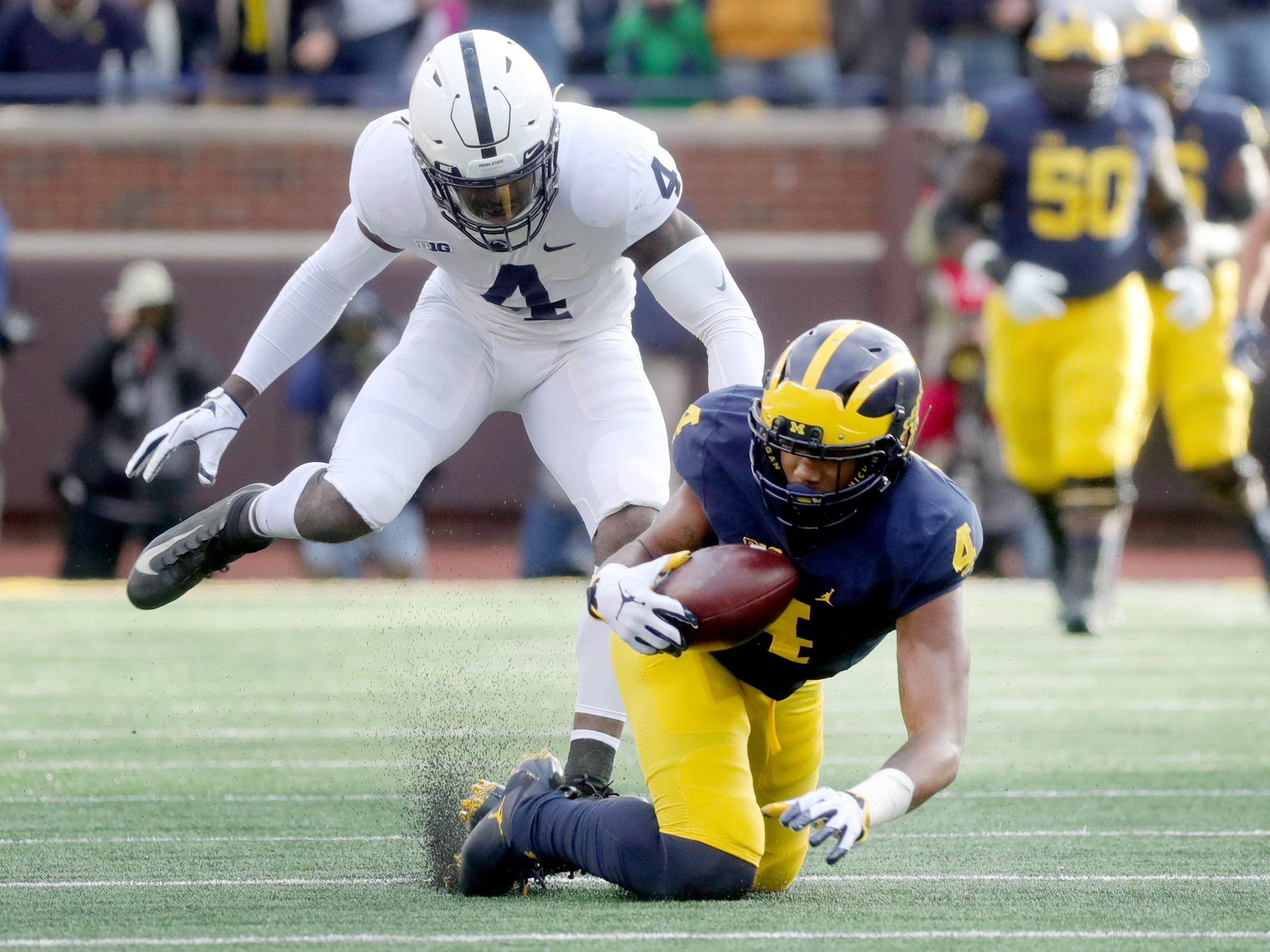 Michigan's Nico Collins makes a catch in front of Penn State's Nick Scott during the first half Saturday, Nov. 3, 2018 at Michigan Stadium in Ann Arbor.