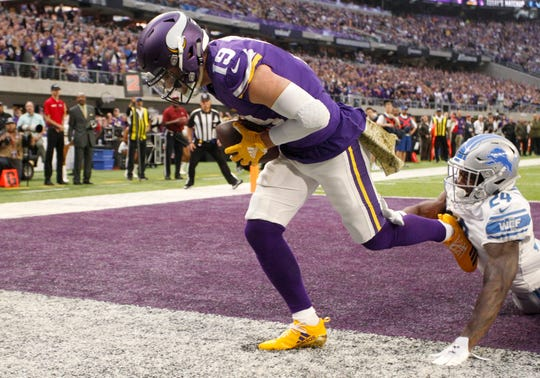 Vikings wide receiver Adam Thielen catches a 2-yard touchdown pass ahead of Lions cornerback Nevin Lawson, right, during the first half on Sunday, Nov. 4, 2018, in Minneapolis.