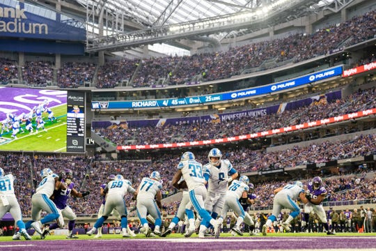 Lions quarterback Matthew Stafford hands the ball off to running back Kerryon Johnson in the third quarter of the Lions' 24-9 loss on Sunday, Nov. 4, 2018, in Minneapolis.