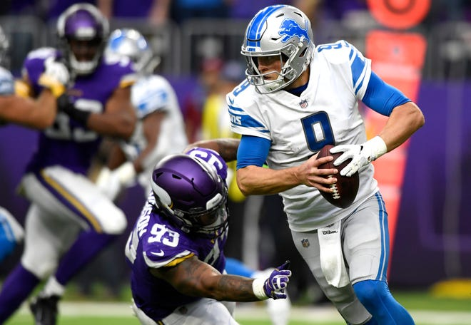 Lions quarterback Matthew Stafford scrambles with the ball while being pursued by Vikings defensive lineman Sheldon Richardson in the first half on Sunday, Nov. 4, 2018, in Minneapolis.