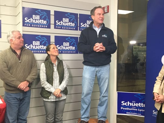 Republican gubernatorial candidate Bill Schuette with his running mate Lisa Posthumus Lyon and state House candidate Brian Meakin during a get-out-the-vote rally in Livonia.