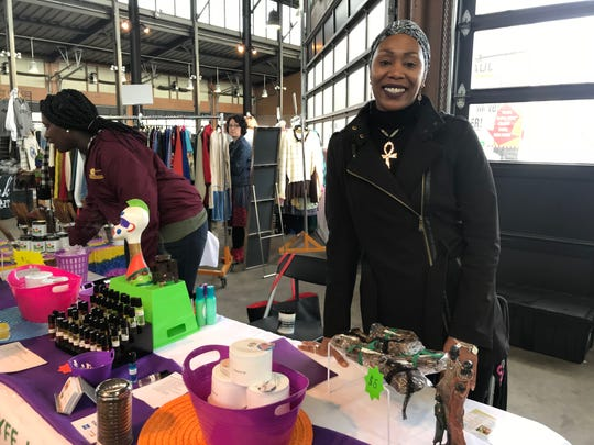 Terri Moody, owner of The Naturaly Lyfe, sells her all-natural wares at the All Things Detroit shopping experience at Eastern Market on Sunday, Nov. 4, 2018.