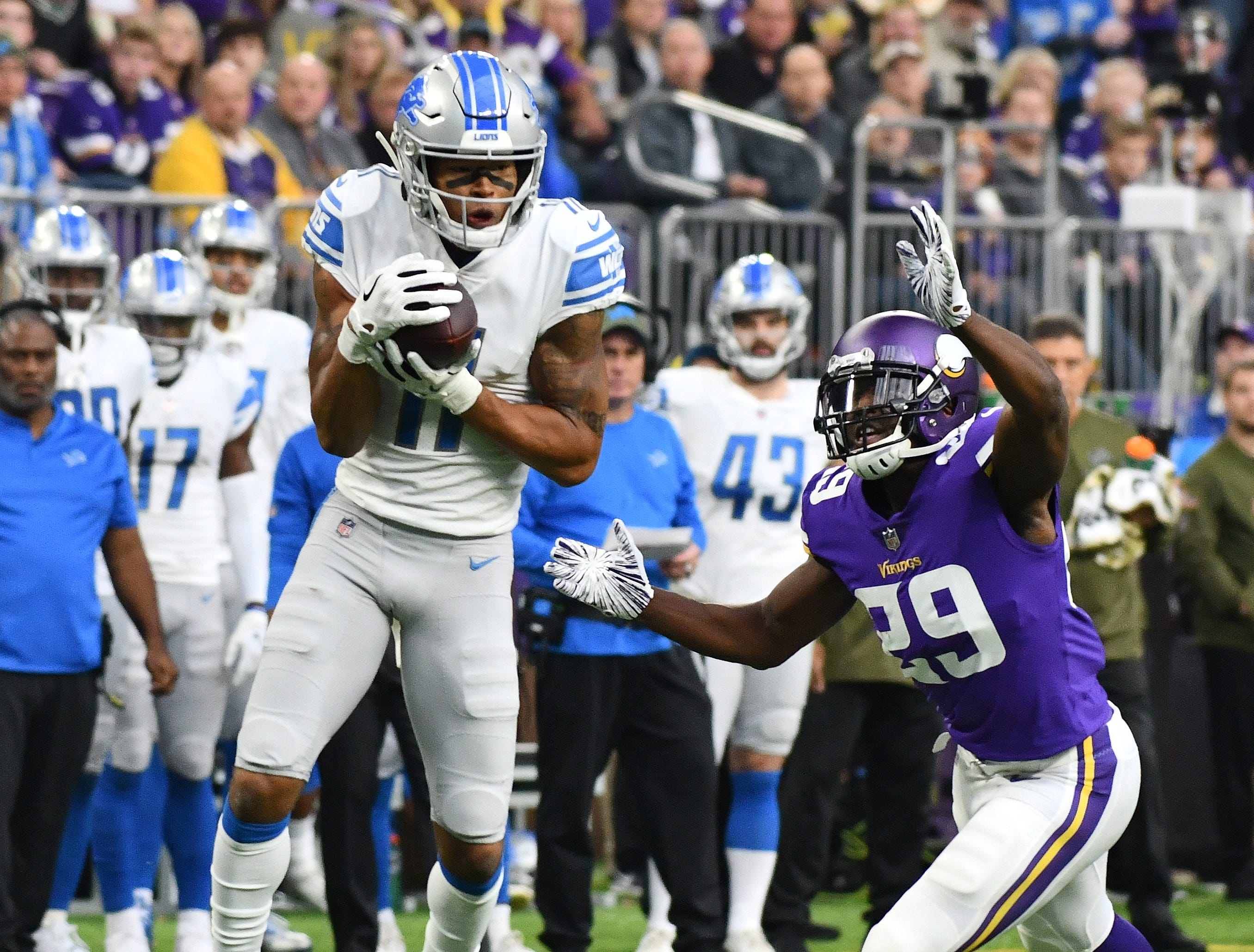 Lions wide receiver Marvin Jones Jr. makes a reception in front of Vikings' Xavier Rhodes but loses it as he is hit, rolling out of bounds, in the third quarter.