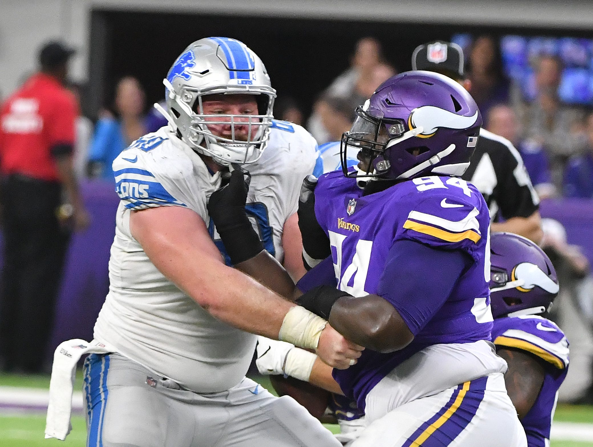 Lions' Graham Glasgow tries to keep the Vikings defense of Jaleel Johnson off of quarterback Matthew Stafford in the fourth quarter.
