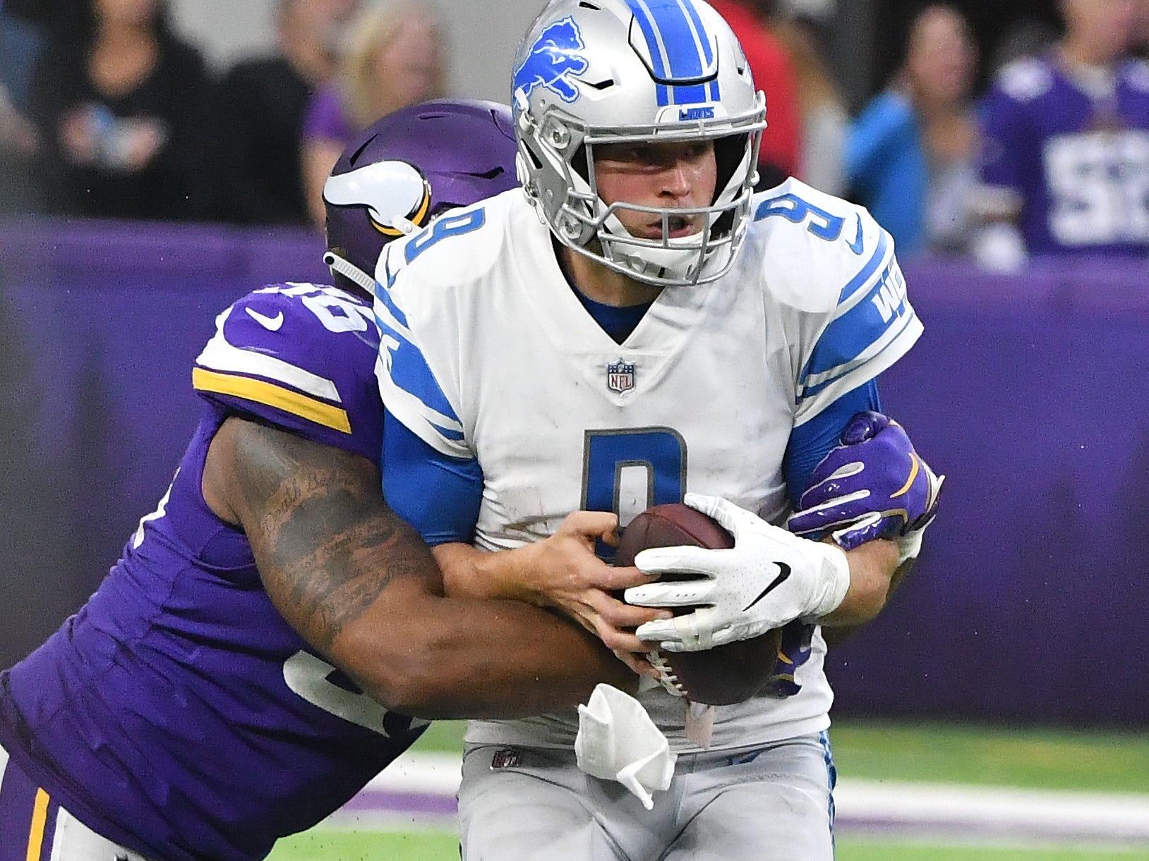 Vikings' Tom Johnson sacks Lions quarterback Matthew Stafford in the fourth quarter.