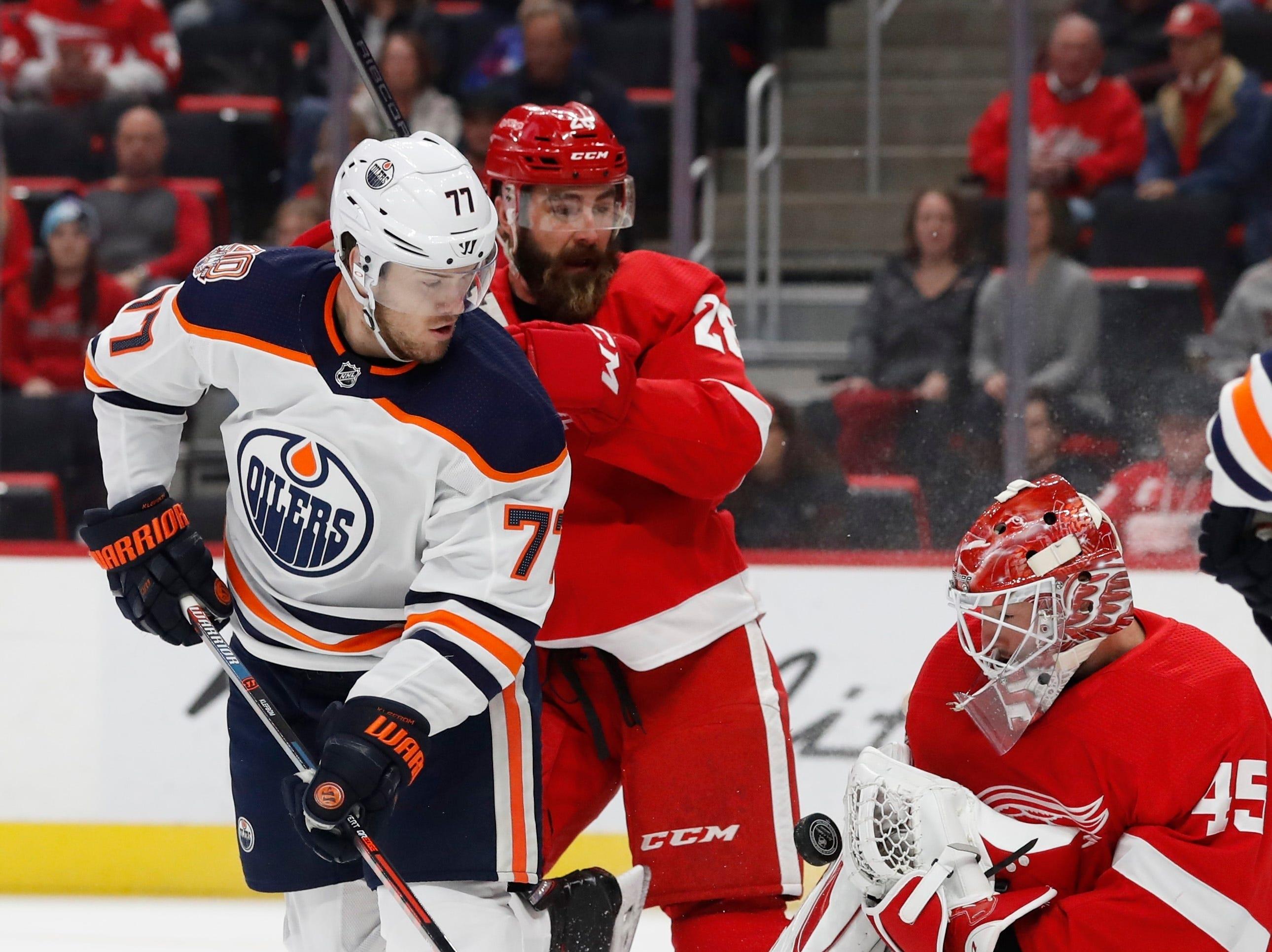 Detroit Red Wings goaltender Jonathan Bernier (45) stops a shot by Edmonton Oilers defenseman Oscar Klefbom (77) during the first period of an NHL hockey game, Saturday, Nov. 3, 2018, in Detroit. (AP Photo/Carlos Osorio)