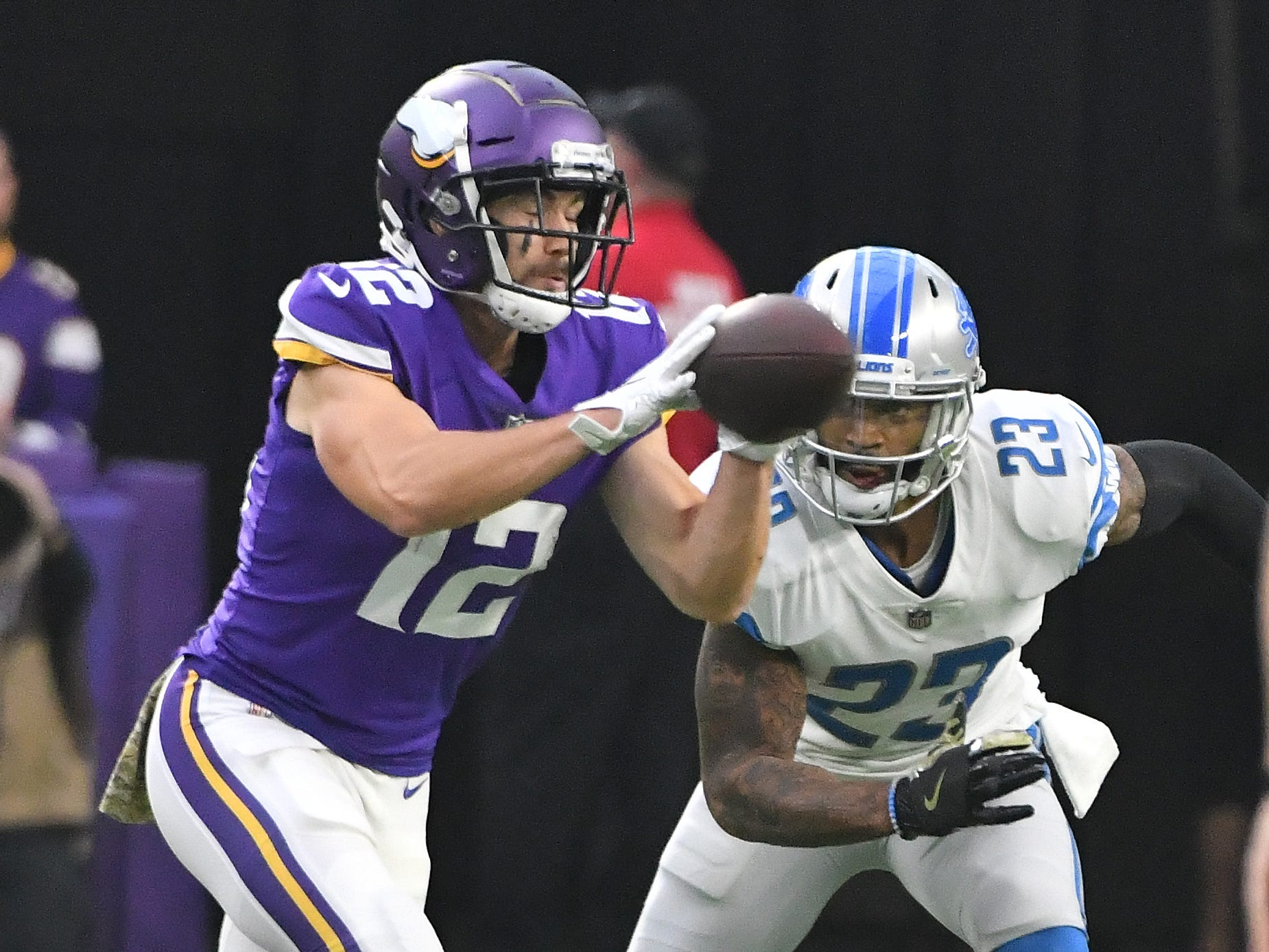 Vikings' Chad Beebe pulls in a reception in front of Lions' Darius Slay in the first quarter.
